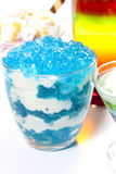 Dessert blue jelly in bowl with whipped cream Royalty Free Stock Photo