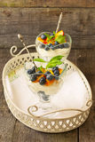 Dessert with  blueberries and peaches Stock Image