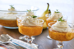 Dessert bowls full of Jell-o and a creamy whipped topping Royalty Free Stock Photos