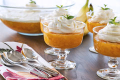 Dessert bowls full of Jell-o with a creamy whipped topping Stock Photos