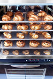 Dessert bread baking in Combi steamer. Production oven at the bakery. Baking bread. Manufacture of bread. Royalty Free Stock Images