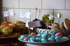 Dessert buffet with cupcakes, macarons and fruit stock image