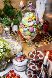 The dessert buffet in the restaurant. Macaroon, cake, candy, marshmallows and other sweets on the festive table stock photos