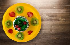 Dessert cake with kiwi and strawberries on a wooden background Stock Photography