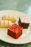 Dessert Cakes. Assortment of sweet and colorful dessert cakes on a plate Stock Photos