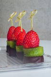 Dessert canape from fruits on the table Royalty Free Stock Images
