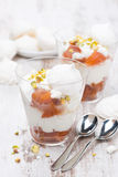 Dessert with canned peaches, whipped cream, meringue, vertical Royalty Free Stock Photography