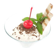 Dessert with cherry on a plate Royalty Free Stock Image
