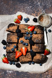 dessert - chocolate brownies with fresh berries, vertical Stock Image