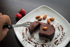 Dessert chocolate cake on a white plate. Stock Photo