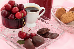 Dessert.1. Chocolate, coffee, sweet cherry, cookies on a crystal tray Royalty Free Stock Photography