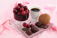 Dessert. Chocolate, coffee, sweet cherry, cookies on a crystal tray Royalty Free Stock Image