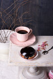 Dessert, chocolate cupcake with coffee and rose petals on atique table. Dessert, chocolate cupcake with coffee and rose petals on atique wooden table Royalty Free Stock Image