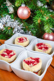Dessert for Christmas. Mini raspberry cheesecakes in muffin form Stock Image