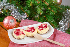 Dessert for Christmas. Mini raspberry cheesecakes in muffin form Stock Images