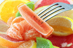 Dessert of citrus marmalade. Dessert of citrus and marmalade on the fork Royalty Free Stock Photos