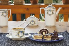 Dessert with coffee, chocolate cakes and rolls on the table, Royalty Free Stock Photography