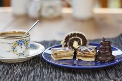 Dessert with coffee, chocolate cakes and rolls on the table, Stock Image