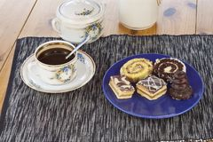 Dessert with coffee, chocolate cakes and rolls on the table, Stock Photos