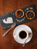Dessert and coffee served on a wooden table. Chocolate dessert and black coffee served on a wooden table Royalty Free Stock Image