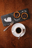 Dessert and coffee served on a wooden table. Chocolate dessert and black coffee served on a wooden table Stock Image