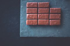 Sweet swiss chocolate candies on a stone tabletop, flatlay. Dessert, confectionery and gluten-free organic food concept - Sweet swiss chocolate candies on a stock images
