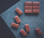 Sweet swiss chocolate candies on a stone tabletop, flatlay. Dessert, confectionery and gluten-free organic food concept - Sweet swiss chocolate candies on a stock photos