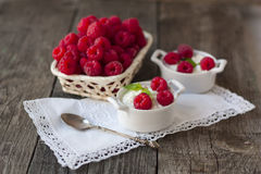 Dessert from cottage cheese and raspberries on a white napkin on. Dessert from cottage cheese and raspberries on a white napkin and fresh raspberries in a basket Stock Photography