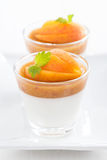 Dessert with cream and apricot jelly, close-up Stock Images