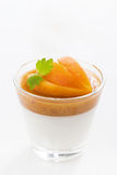 Dessert with cream and apricot jelly in a glass, close-up Stock Photos