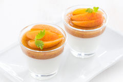 Dessert with cream and apricot jelly in glasses, top view Stock Photo