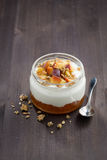 Dessert with cream, granola and peach jam, vertical Royalty Free Stock Photo