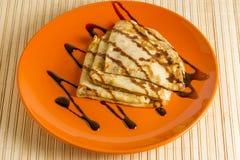 Dessert crepes with chocolate sauce Stock Photos