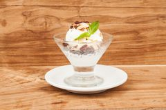 Dessert cup with ice cream and red berries. Glass with vanilla ice cream and red berries Stock Photography