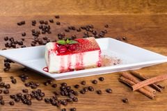 Dessert. Curd cheese cake with raspberries and raspberry syrup royalty free stock photos