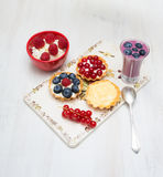 Dessert currant bilberry raspberry milk on a wooden board Stock Photography