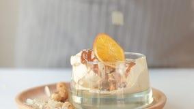 Dessert decor serving ice cream nut caramel citrus stock video footage