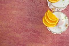 Dessert del latte con le arance Fotografia Stock