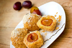 Dessert, delicacy - Dumplings with plums Royalty Free Stock Images