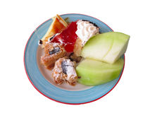 Dessert on dish - cakes and mellon isolated over white Royalty Free Stock Photo