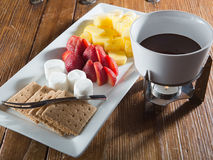 Dessert Fondue featuring pineapple, marshmallows, strawberries and graham crackers Stock Photos