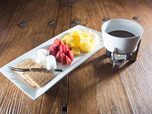 Dessert Fondue featuring pineapple, marshmallows, strawberries and graham crackers Royalty Free Stock Photo