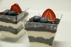 Dessert food blueberry panacota in glass. A Dessert food blueberry panacota in glass stock photography