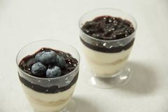 Dessert food blueberry panacota in glass. A Dessert food blueberry panacota in glass royalty free stock photos