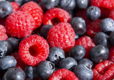 Dessert, fresh berries close-up. The texture of berries, raspberries and blue-berries, macro shot Stock Photo