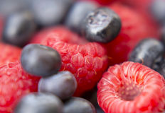 Dessert, fresh berries close-up. The texture of berries, raspberries and blue-berries, macro shot Stock Photos