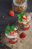 Dessert with fresh berries, cottage  cheese, granola and berries. Jam Royalty Free Stock Images