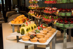 Dessert with fresh fruit on buffet line, sweet Stock Images