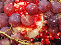 Dessert with fresh grape and pomegranate grains. Stock Photography