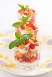 Dessert with fresh strawberries, apricots and whipped cream Stock Images